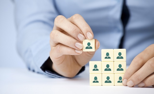Human resources, social networking and assessment center concept - recruiter complete team by one person (employee) represented by icon.